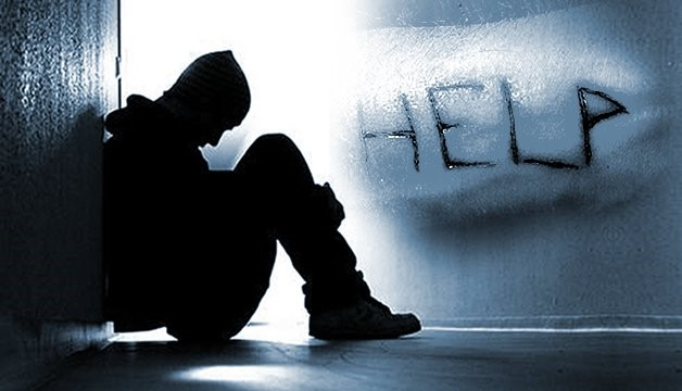 A silhouetted figure with the word help in the background
